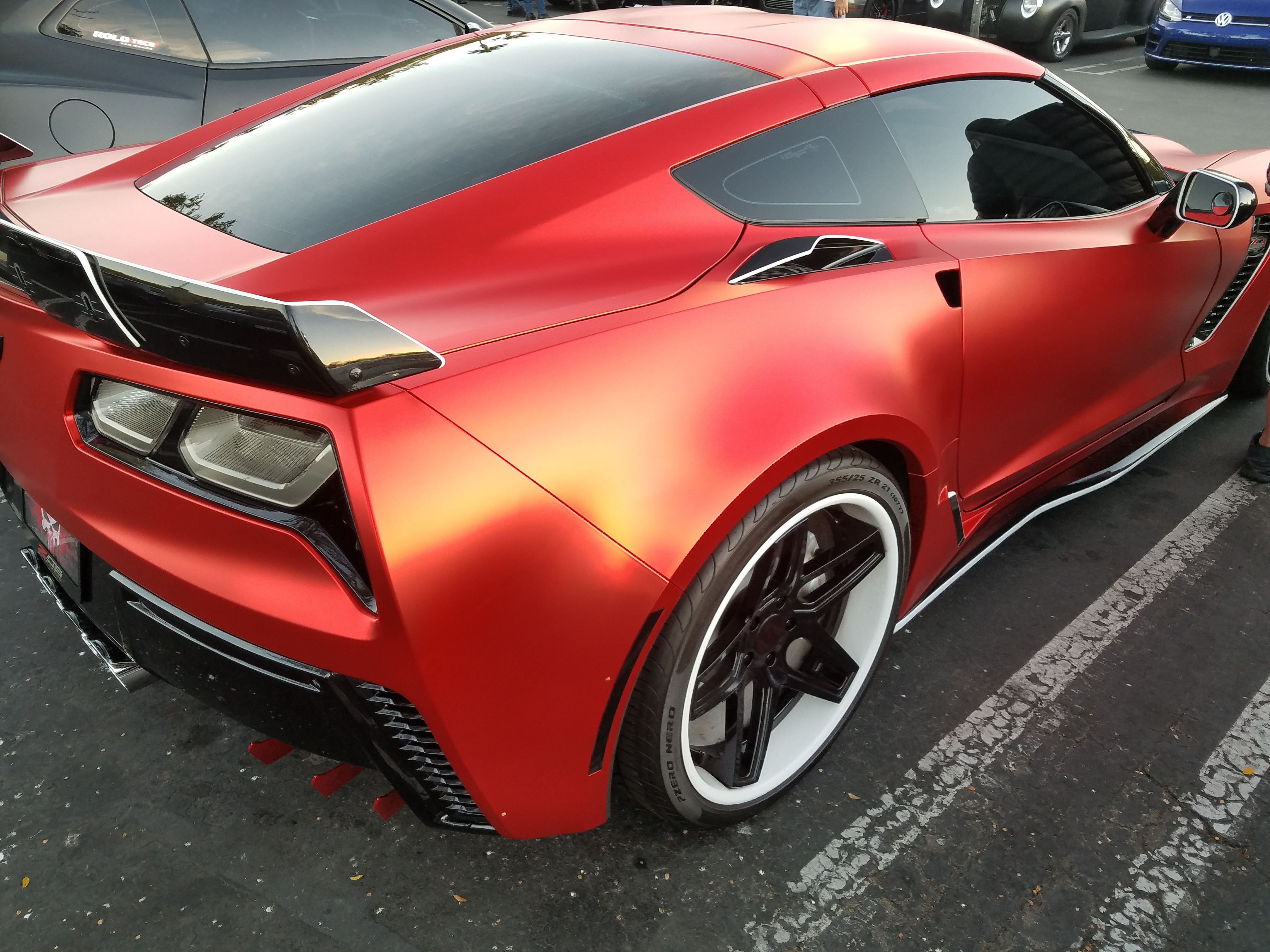 """ZO6 wrapped with 21x13"""" rear wheels and scissor doors"""